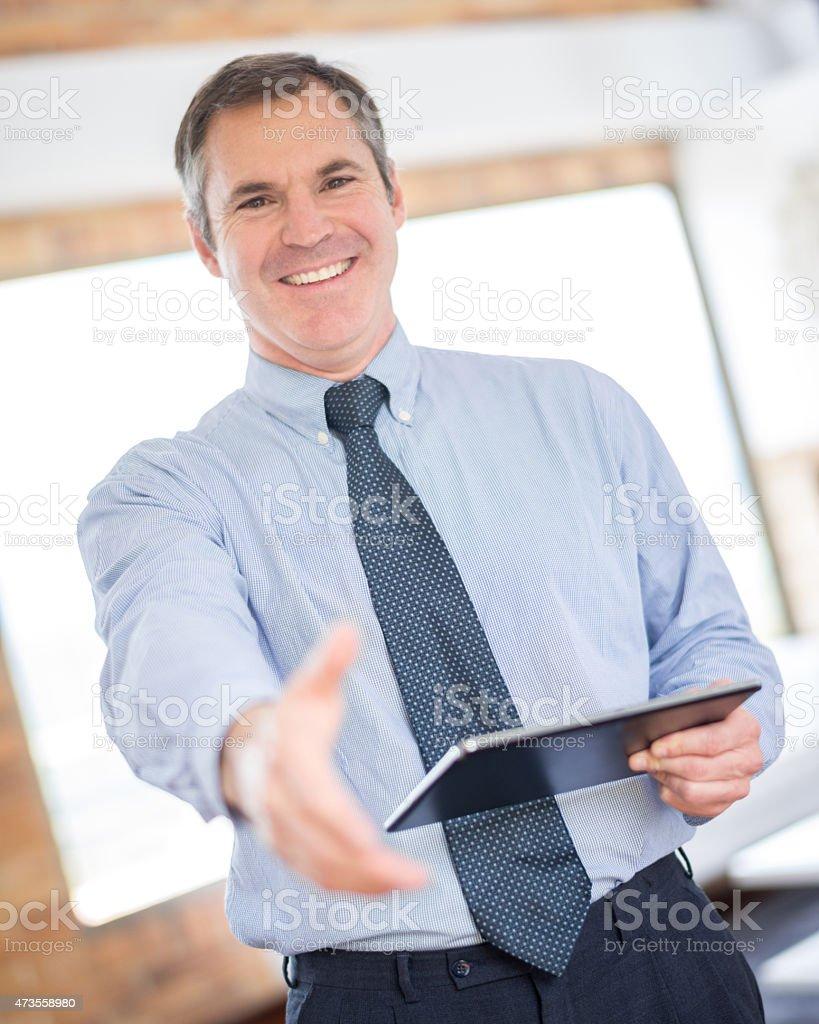 Real estate developer ready to handshake stock photo
