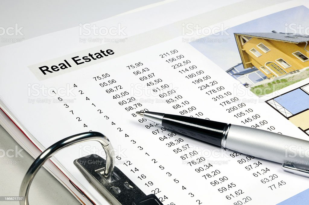 Real Estate - folder with data stock photo