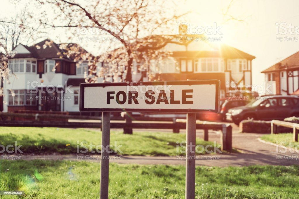 Real estate for sale sign at suburban neighbourhood stock photo