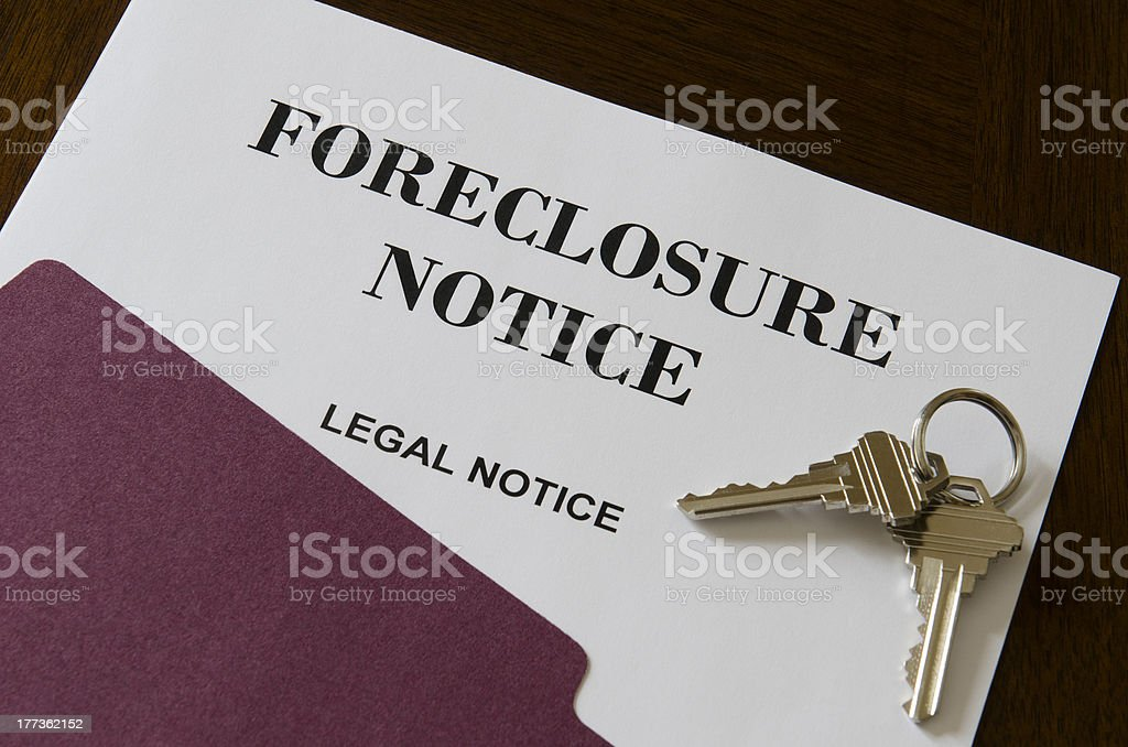 Real Estate Home Foreclosure Legal Notice and Keys stock photo