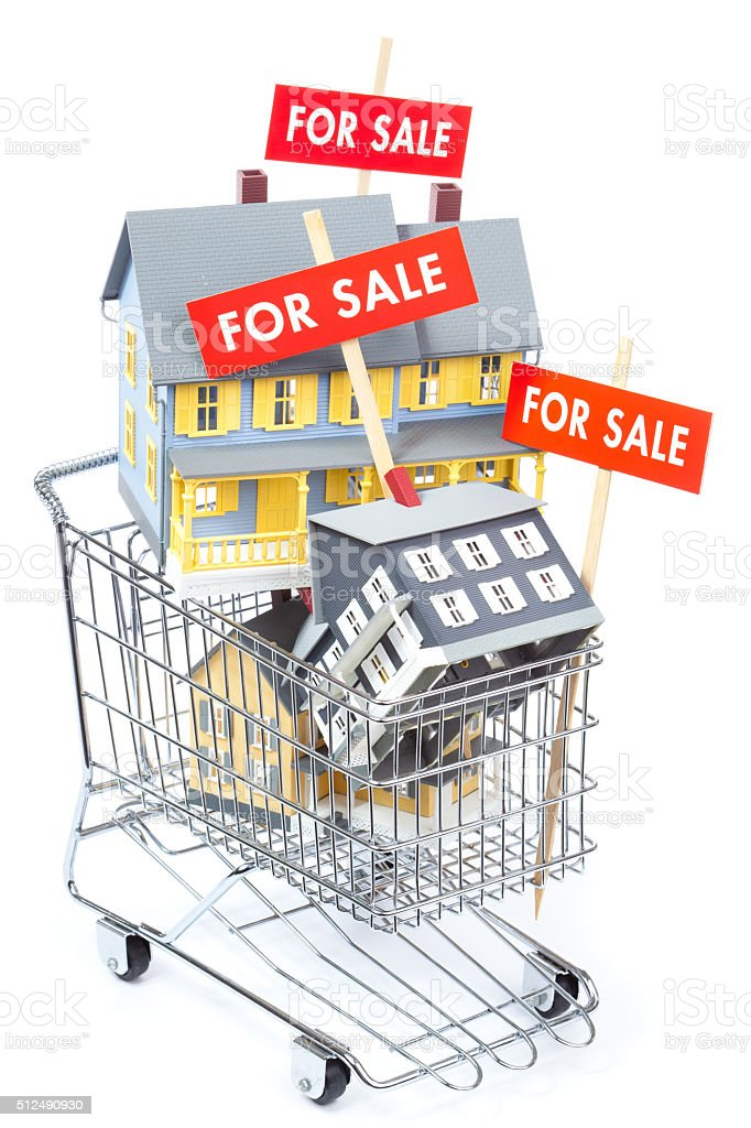 Real Estate House Shopping Cart, Selling with FOR SALE Signs stock photo