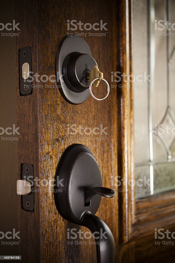 Real Estate:  Open door.  Lock and key to modern home. stock photo