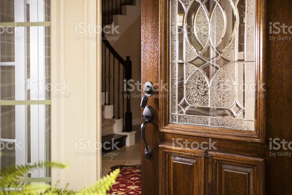 Real Estate: Open front door, upscale modern home.  Foyer. stock photo