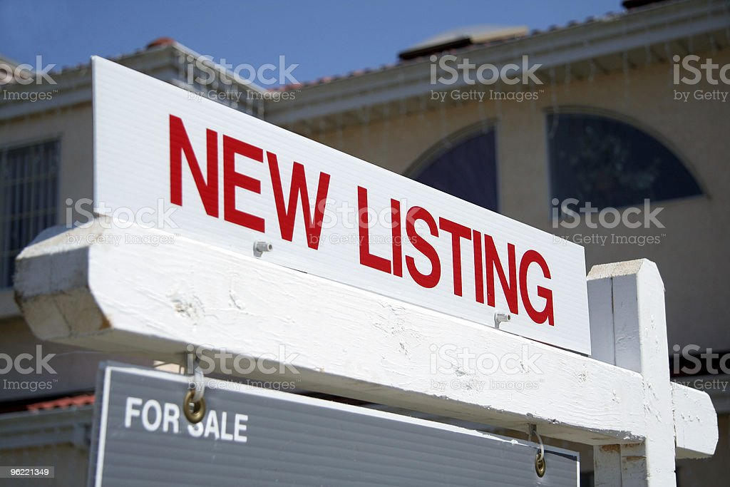Real Estate red 'New Listing' sign stock photo