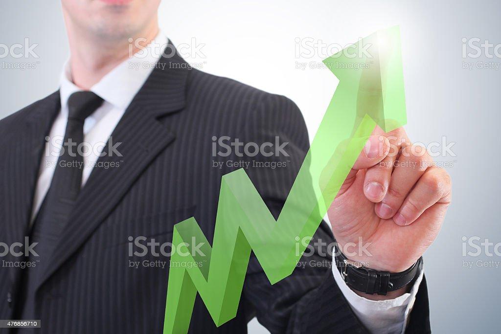 real estate rising arrow stock photo
