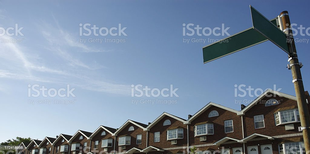 Real Estate Row of Townhouses Blank Street Signs Blue Sky royalty-free stock photo