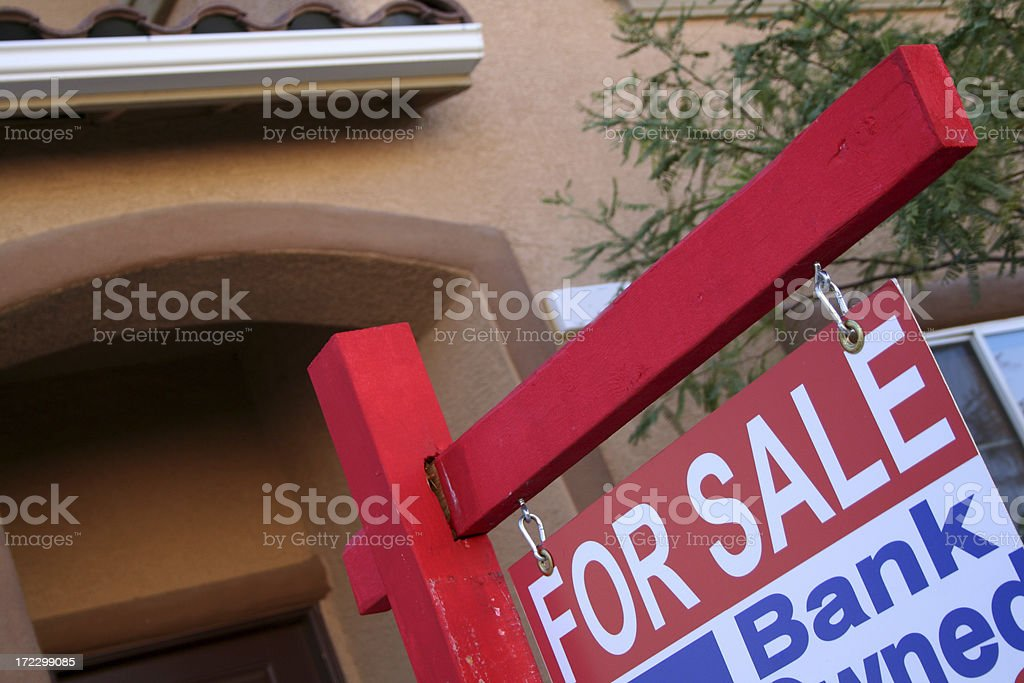 Real Estate sign in front of house royalty-free stock photo