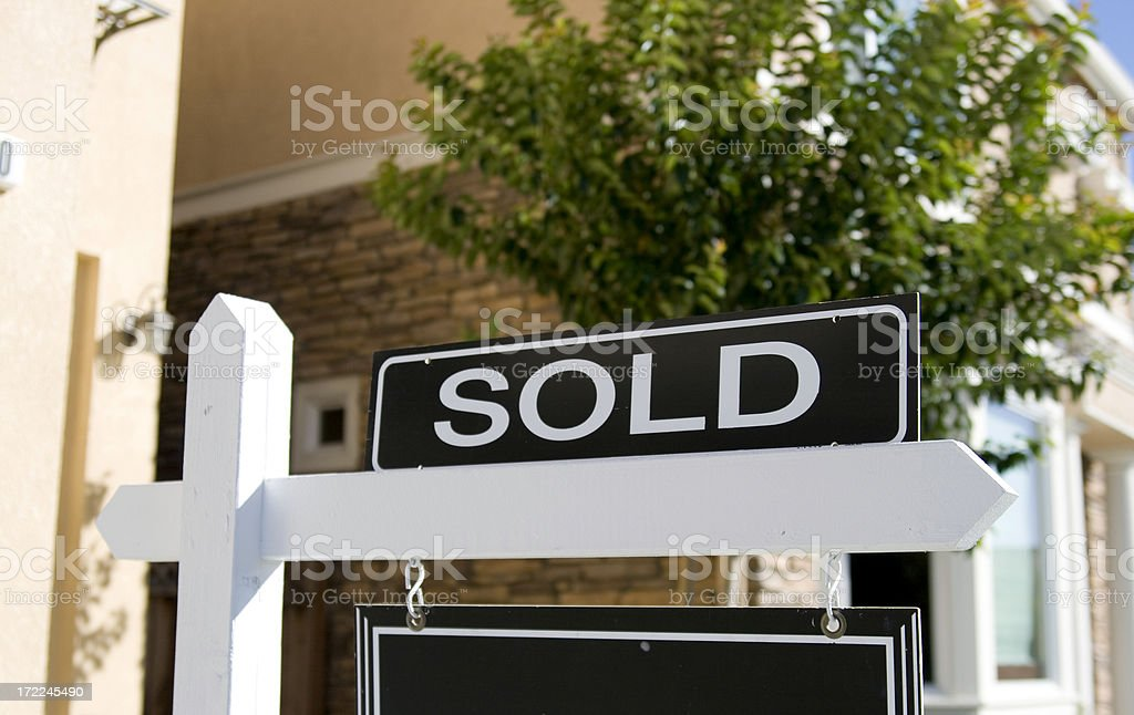 A real estate sign saying sold stock photo