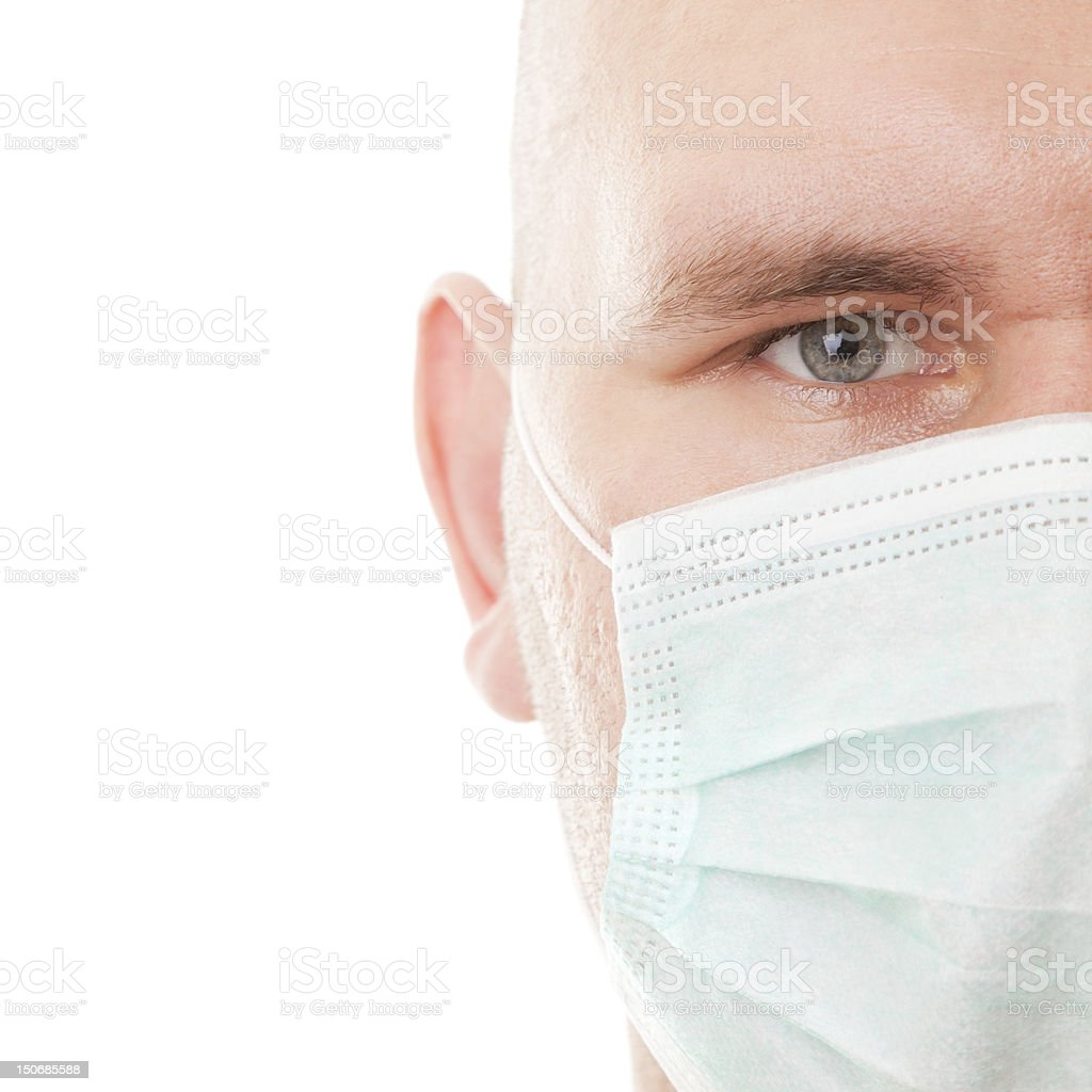 Real face in surgical mask stock photo
