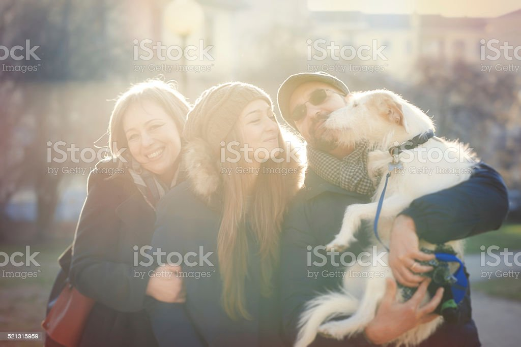Real family with dog in the park stock photo