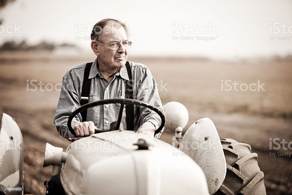 Real Farmer on Tractor royalty-free stock photo