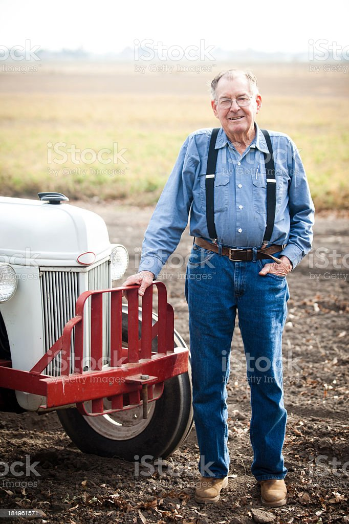 Real Farmer with Tractor royalty-free stock photo