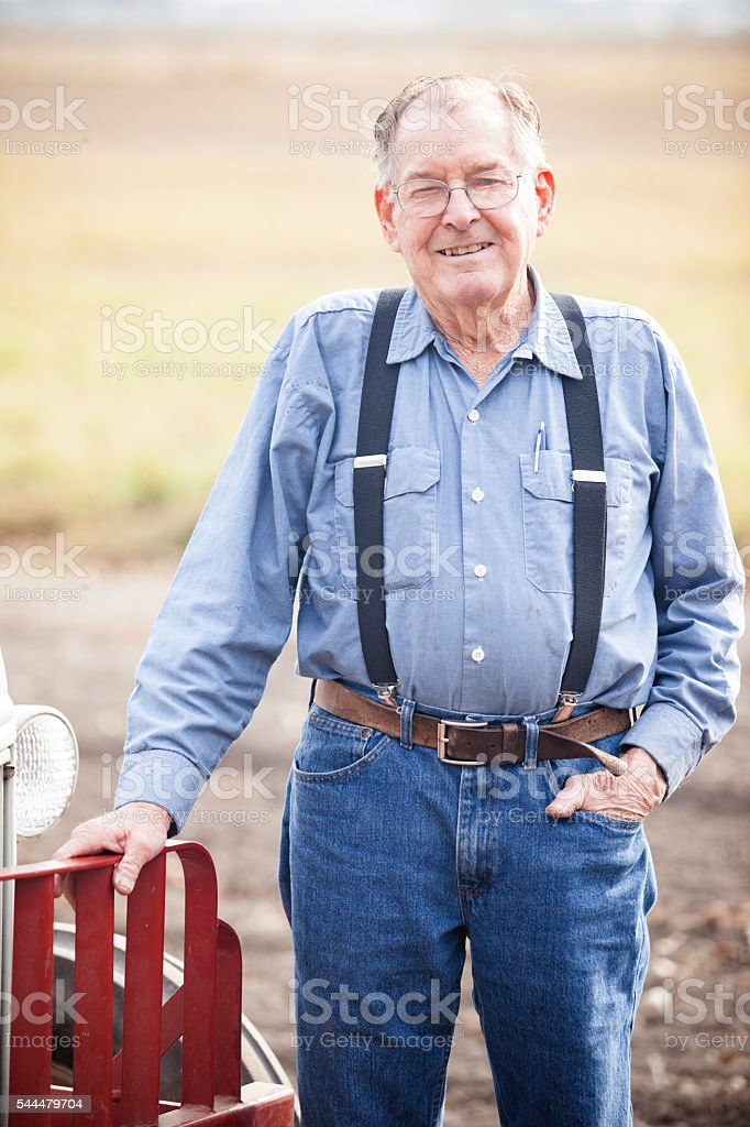 Real Farmer with Tractor stock photo