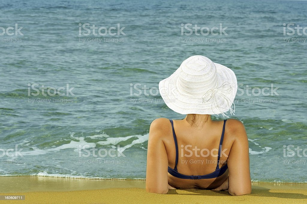 Real female beauty relaxing at beach royalty-free stock photo