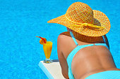 Real female beauty relaxing at swimming pool