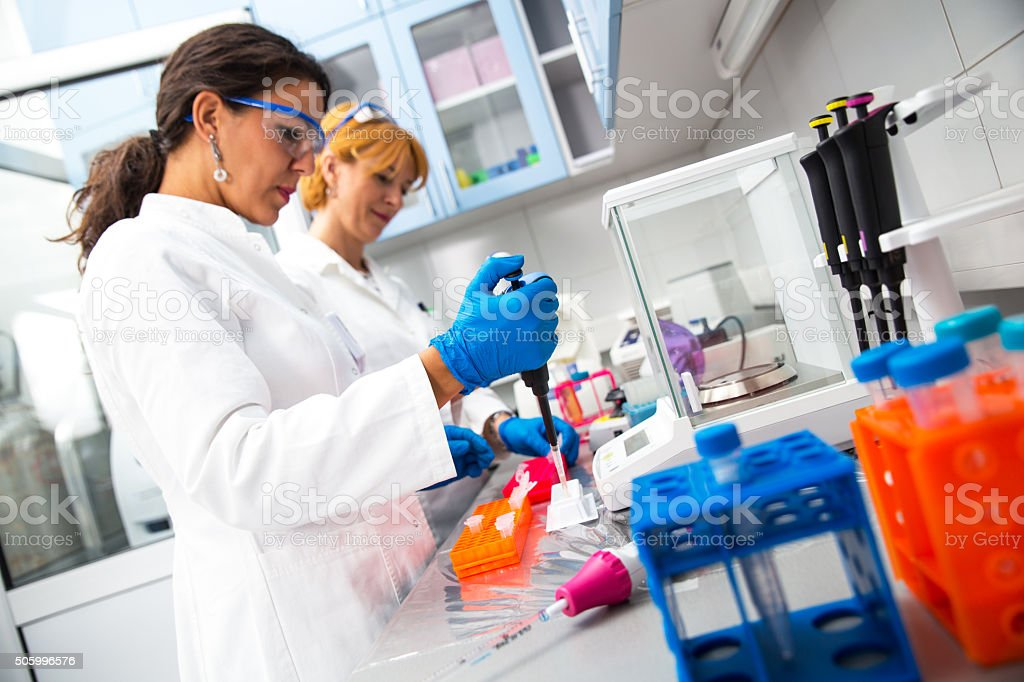 Real female scientists researching stock photo