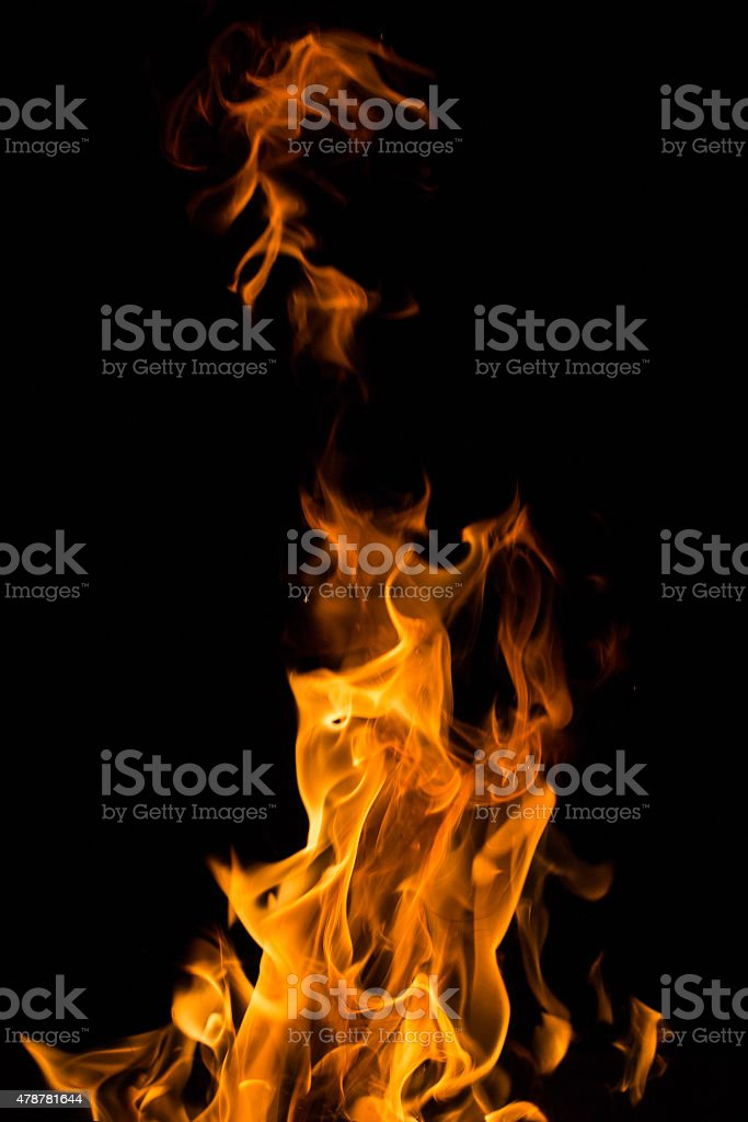 Real fire flames isolated on black stock photo