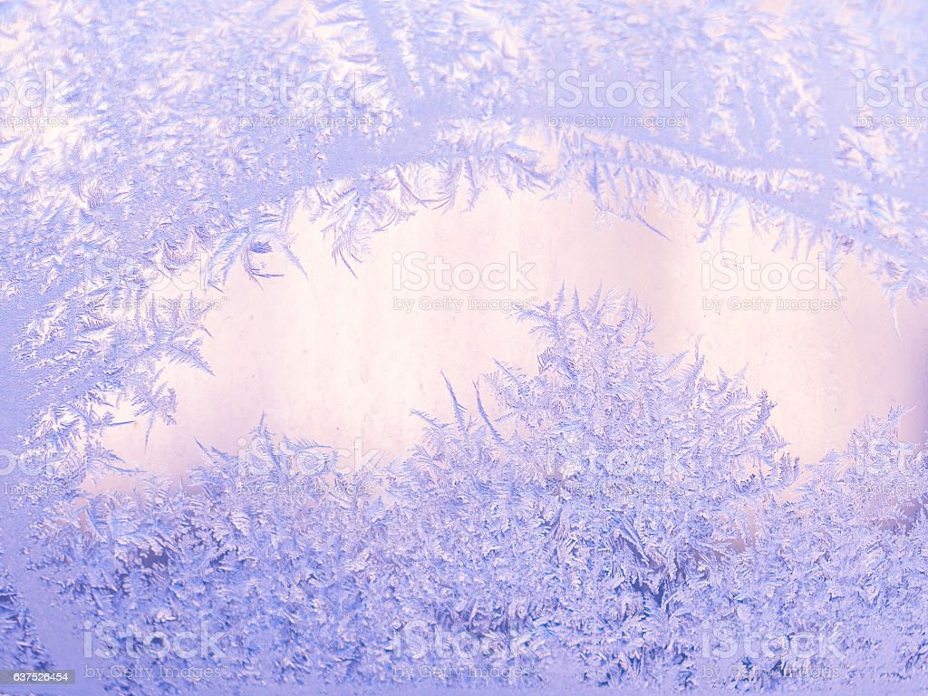 Real frosty pattern on the window. Winter background. Frosted glass stock photo