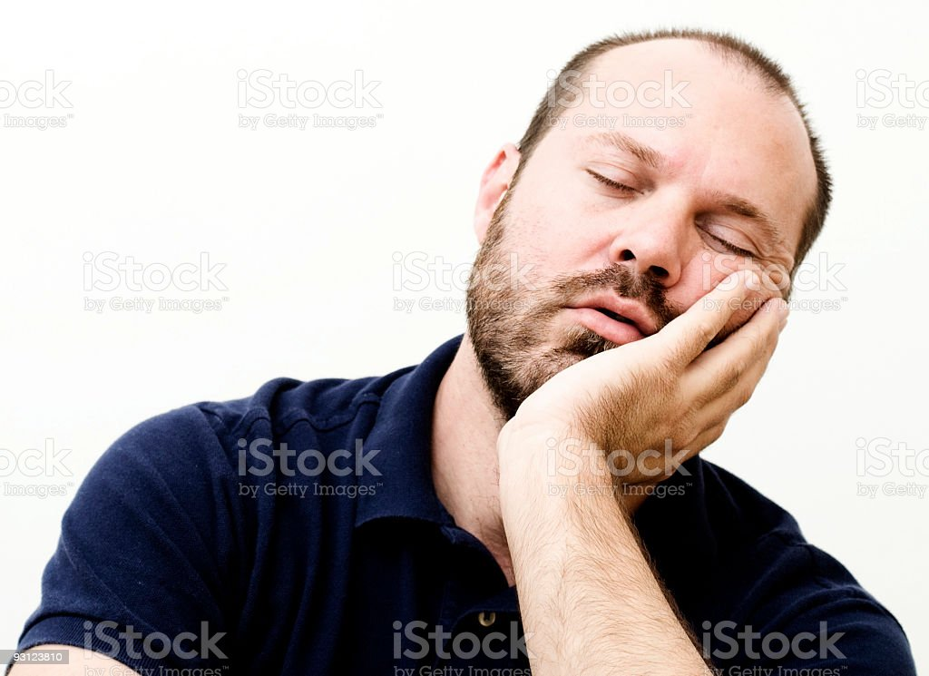 Real guy sleepy leaning on left hand stock photo
