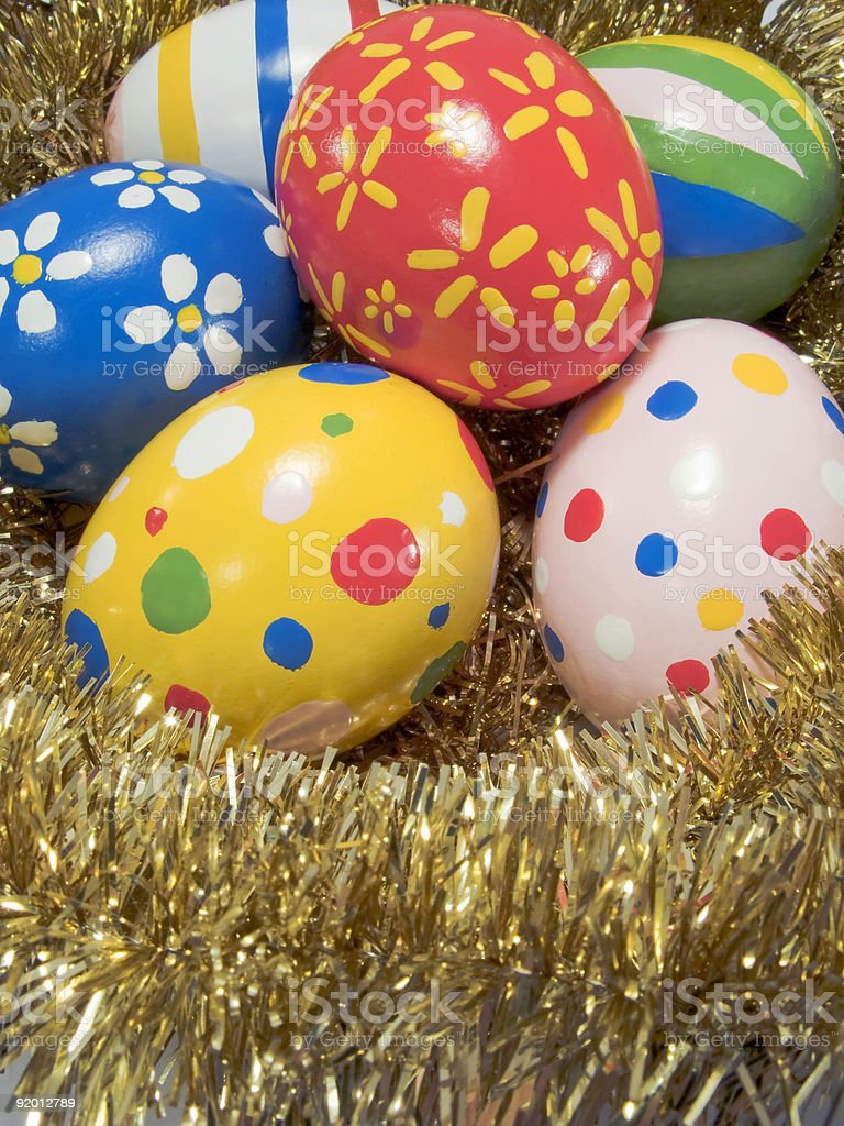 Real hand painted Easter eggs in a golden nest royalty-free stock photo