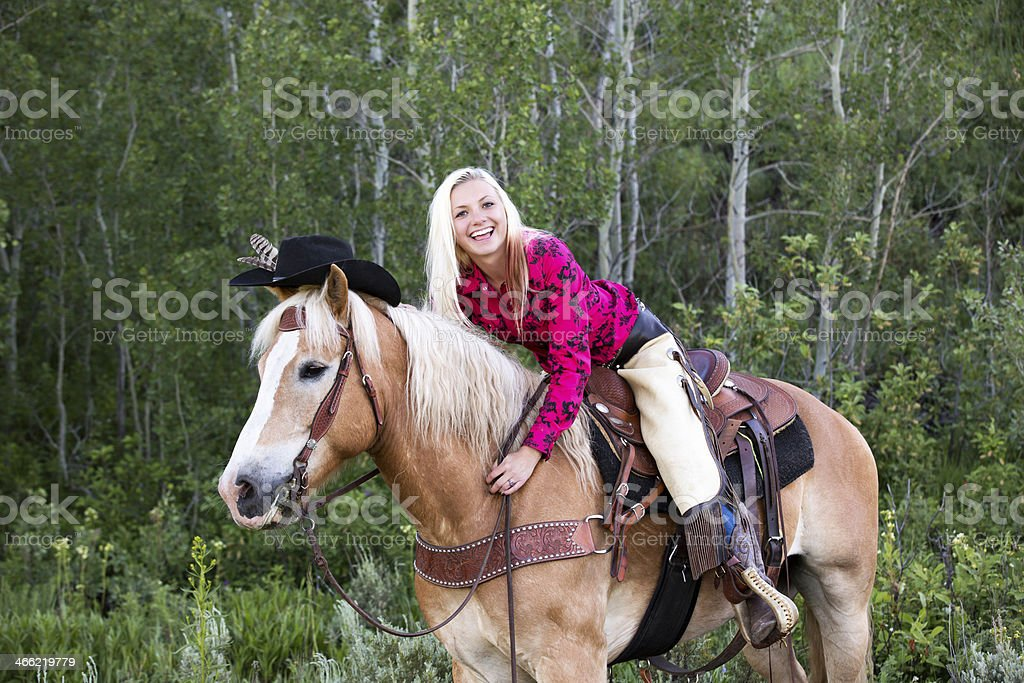 Real High School Cowgirl Laughing On Her Horse royalty-free stock photo
