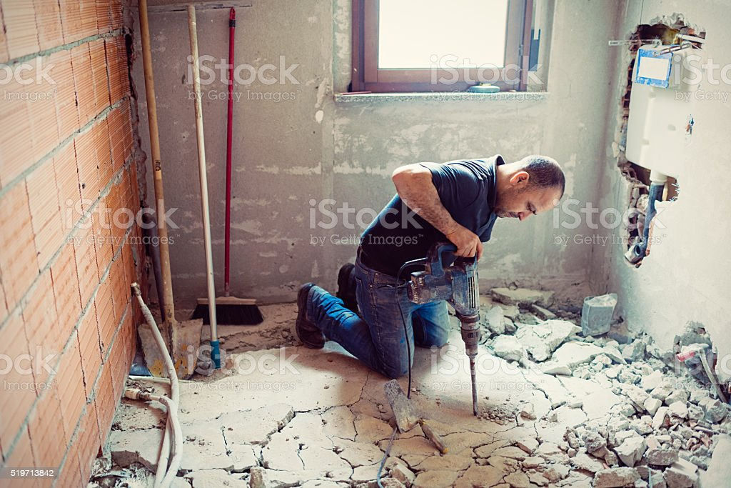 Real Italian builder at work place stock photo
