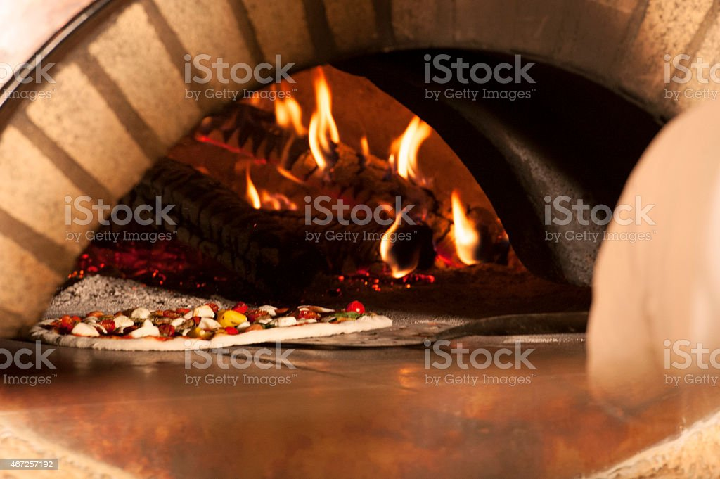 Real Italian Pizza and wood oven stock photo