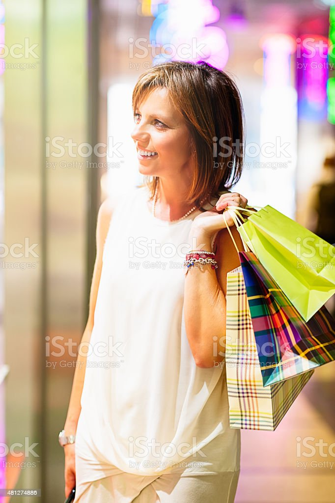 Real Italian woman at the moment of shopping stock photo