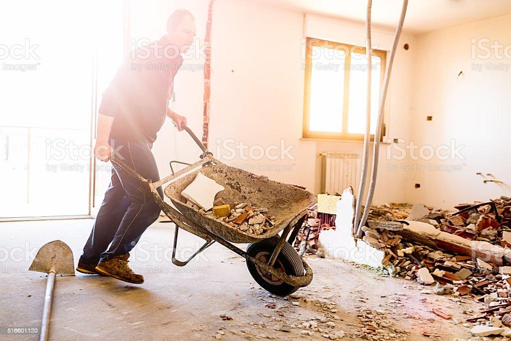 Real Italian worker repairing apartment stock photo