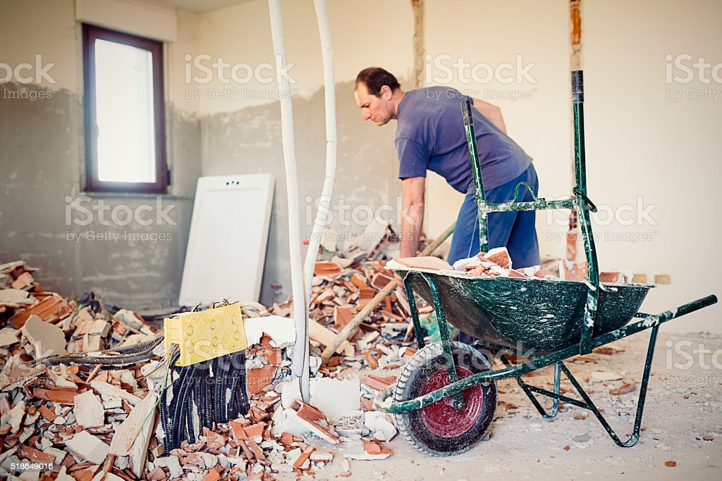 Real Italian worker repairing apartment stock photo