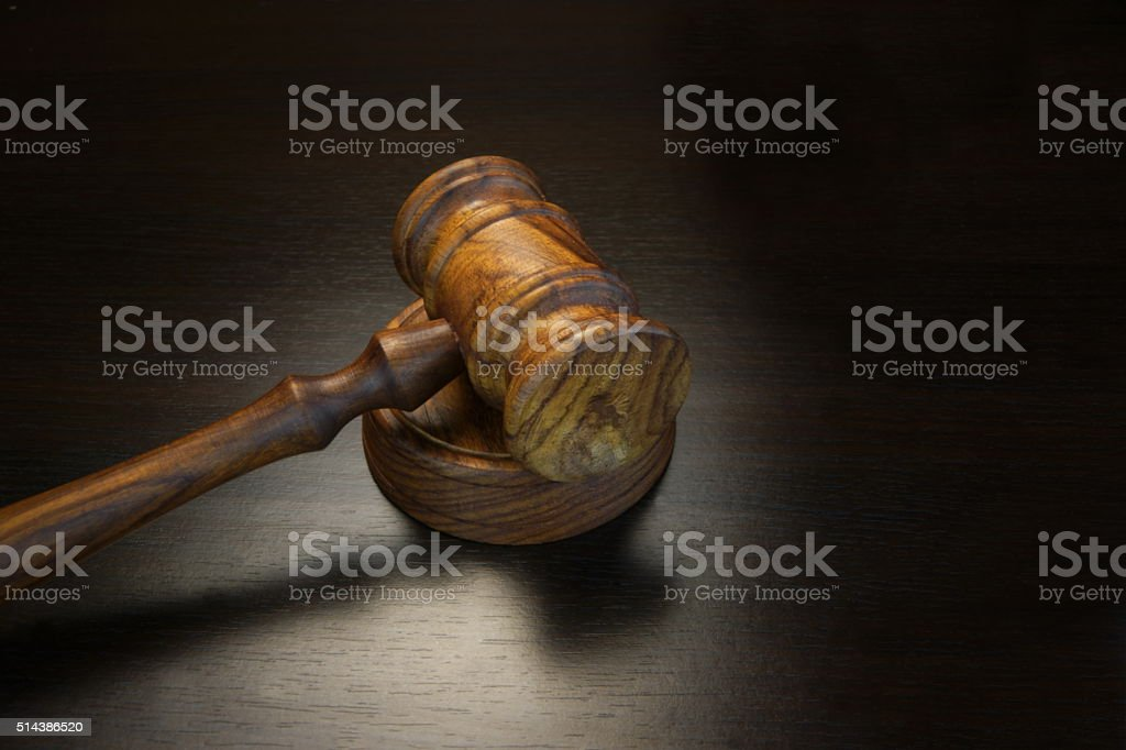 Real Judges Or Auctioneer Gavel On The Black Wooden Table stock photo