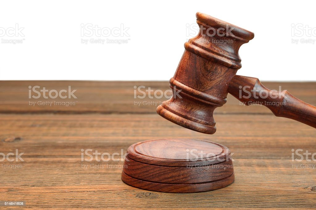 Real Judges Or Auctioneer Gavel On Wood Table  White Isolated stock photo