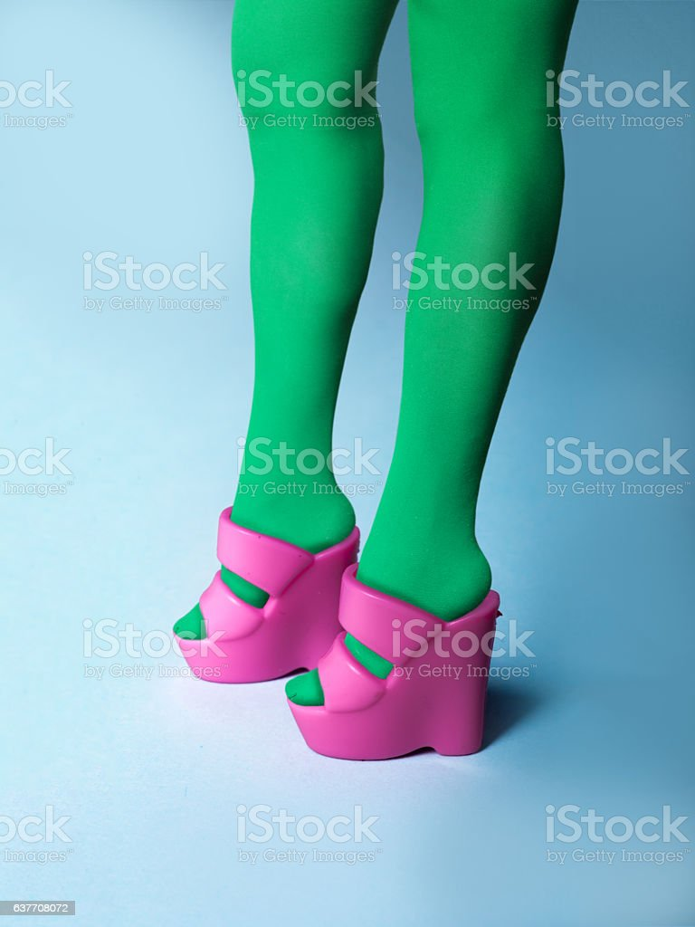 Real legs in fashion doll toy wedge heel sandals stock photo