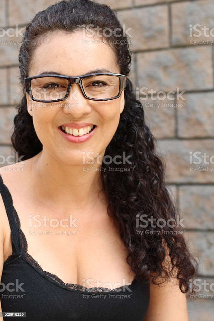 Real looking woman with glasses smiles stock photo