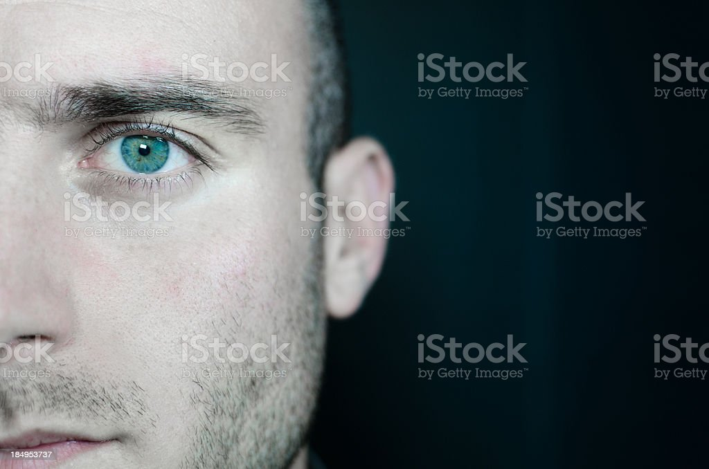 Real man eye in the darkness royalty-free stock photo