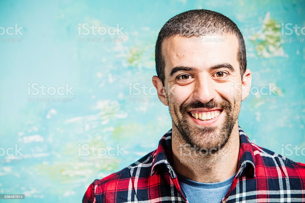 Real man smiling into camera stock photo