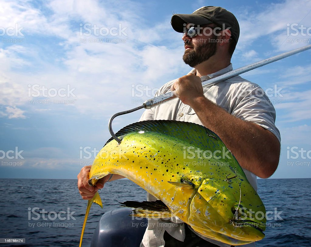 Real Man With Beard Holding Fish stock photo
