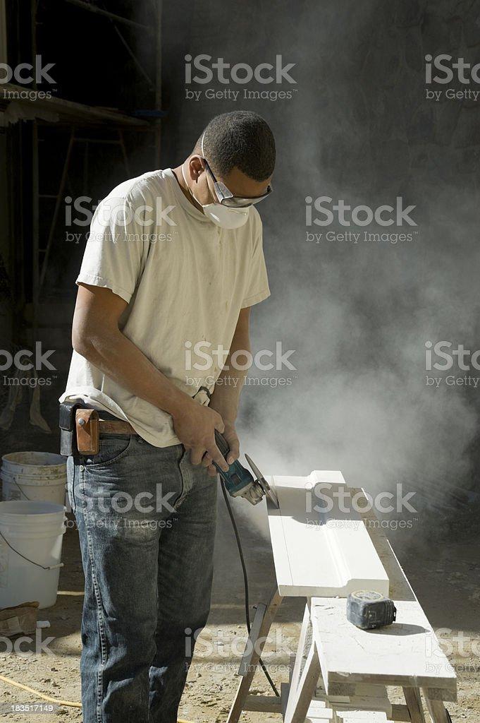 real mason grinding decorative stone stock photo