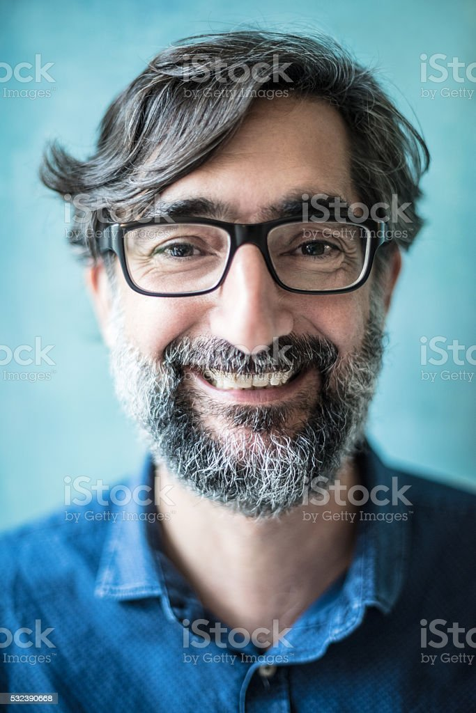 Real mature man smiling with beard, close up headshot portrait stock photo