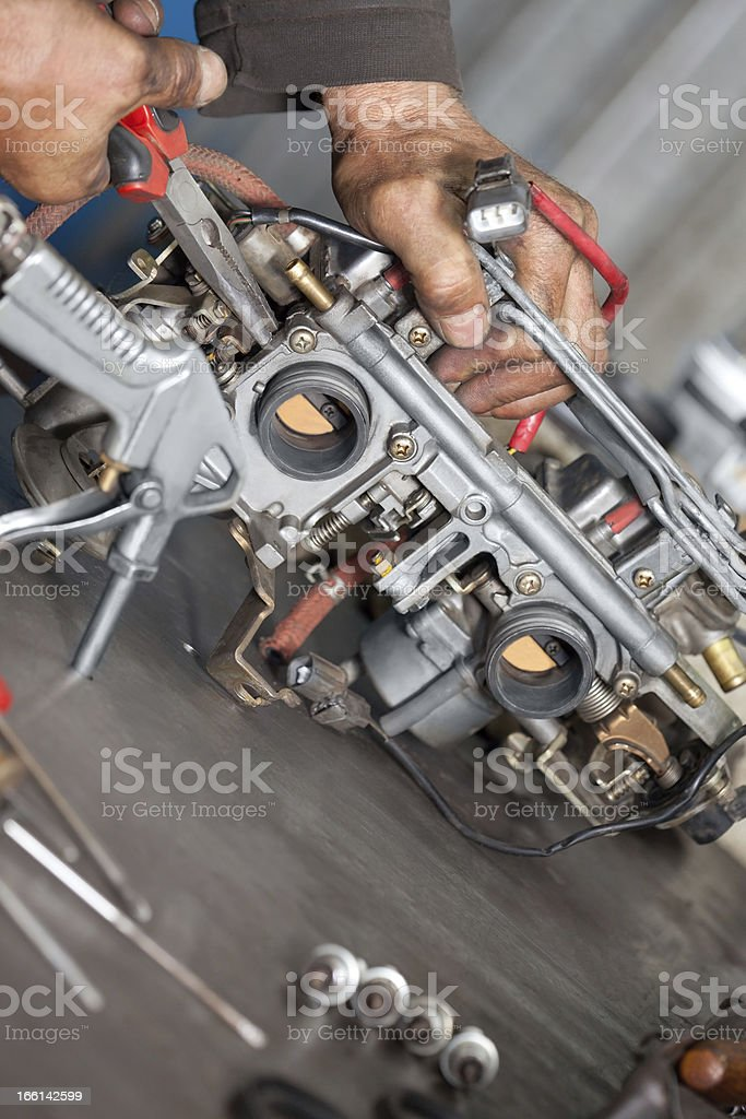 Real Mechanic working  in Auto Repair Shop. royalty-free stock photo
