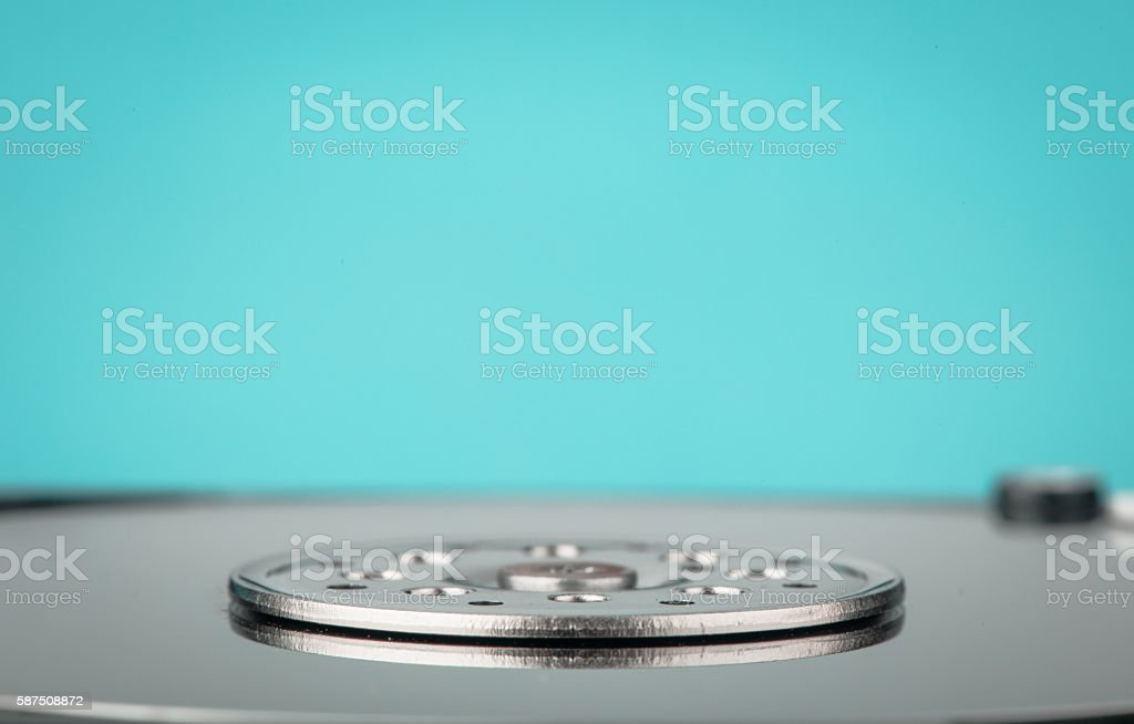 real open computer hard drive on a blue background stock photo
