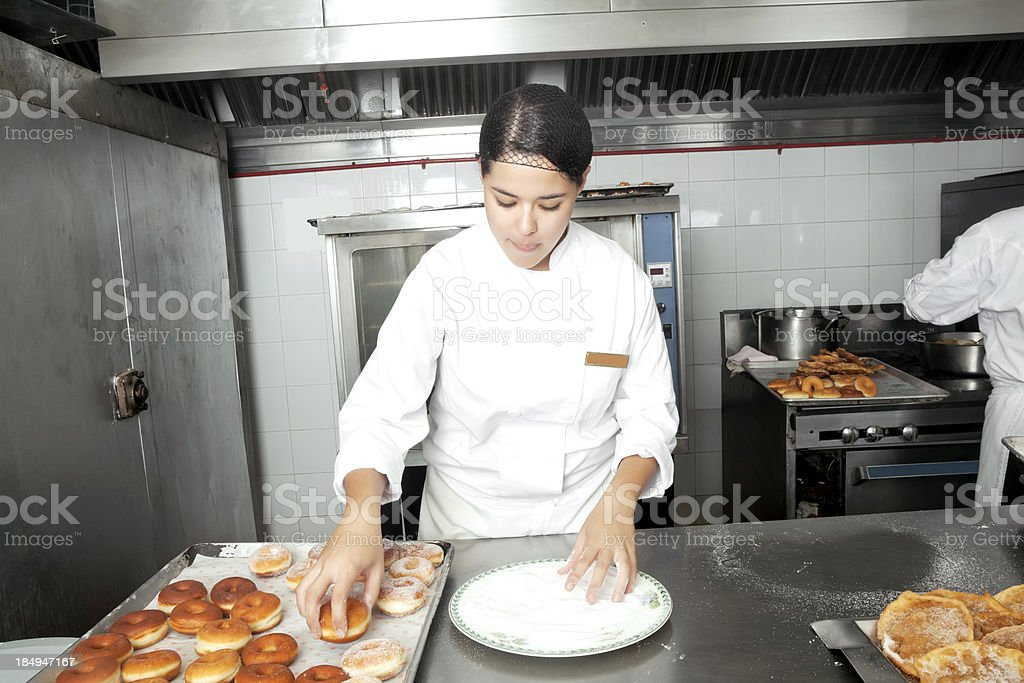 Real Pastry Chefs sugar coating donuts royalty-free stock photo