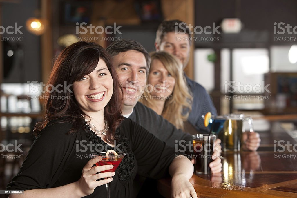 Real People: Adult Couples Enjoy Night Out at Bar royalty-free stock photo