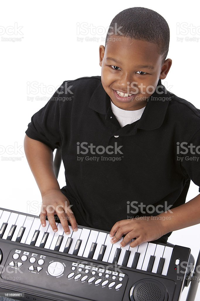 Real People: African American Boy Playing Organ Piano Keyboard royalty-free stock photo