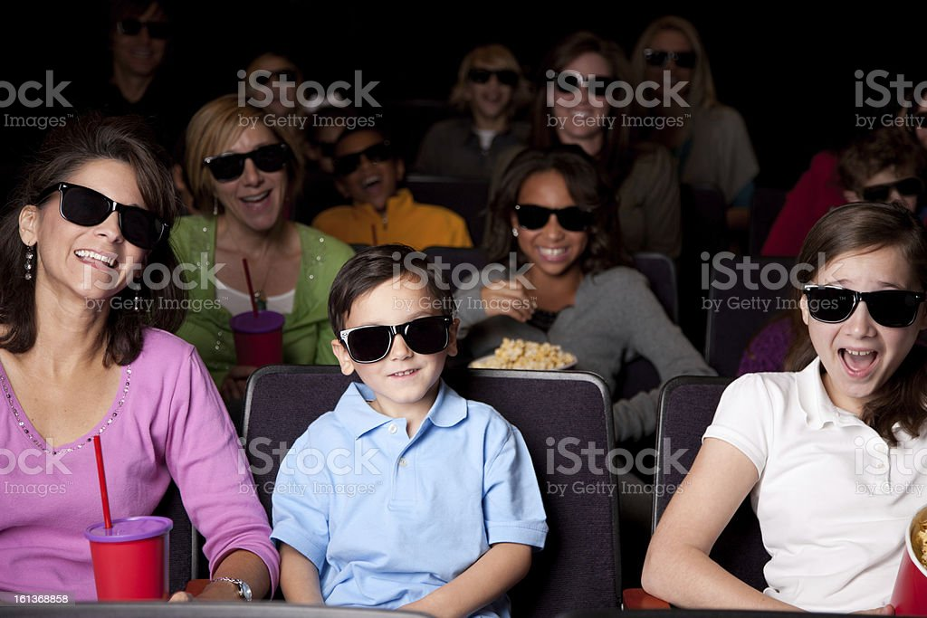 Real People Audience: Adults Children Watching 3D Movie Theater royalty-free stock photo