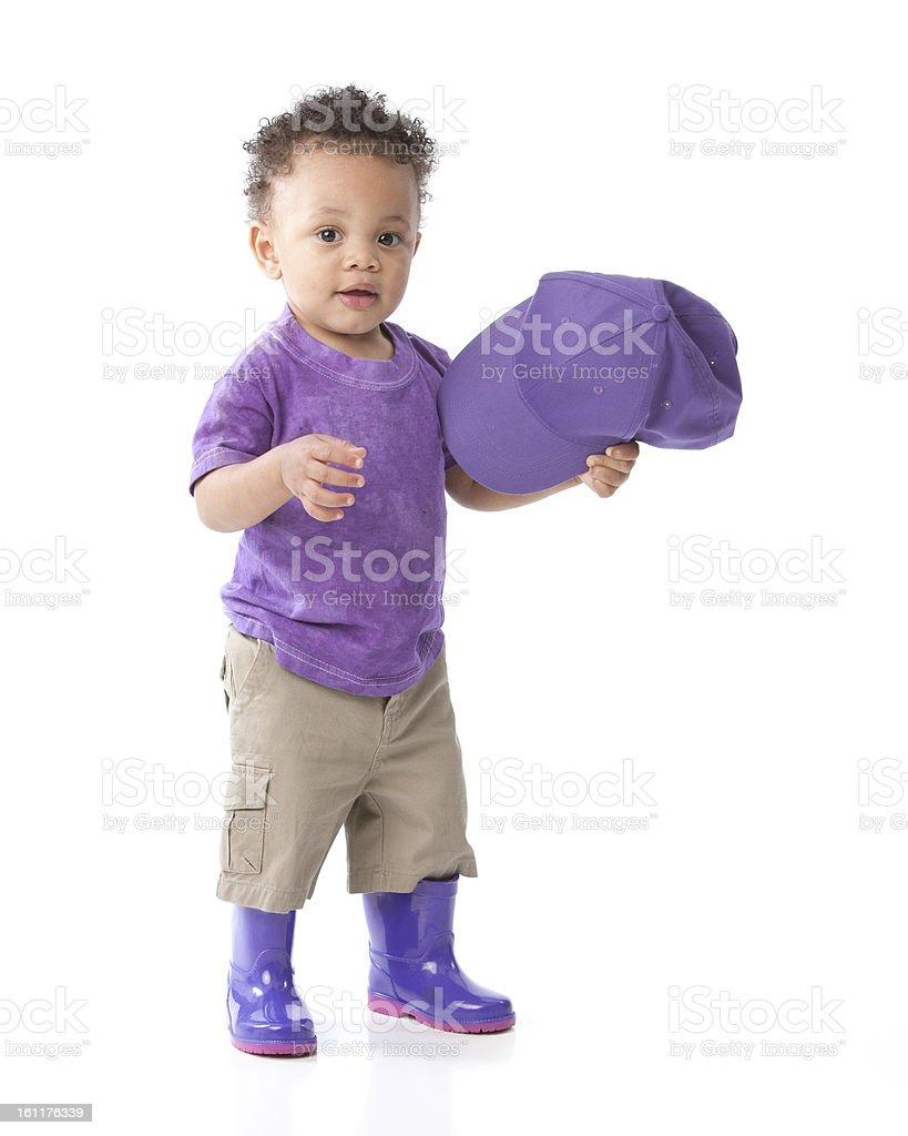 Real People: Black African American Toddler Boy Purple Cap Galoshes royalty-free stock photo