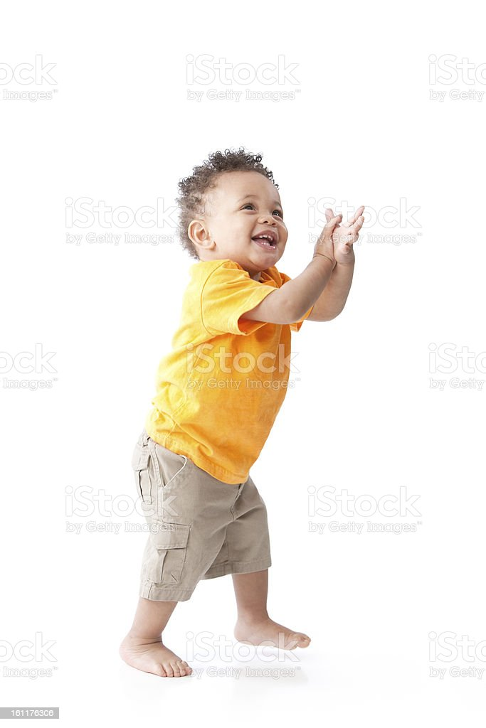 Real People: Black Laughing Toddler Boy Orange Standing Clapping royalty-free stock photo