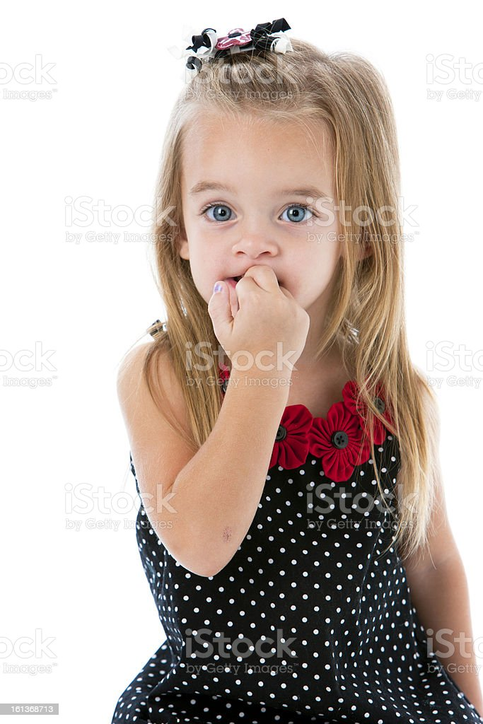 Real People: Caucasian Little Girl Biting Her Fingernails stock photo