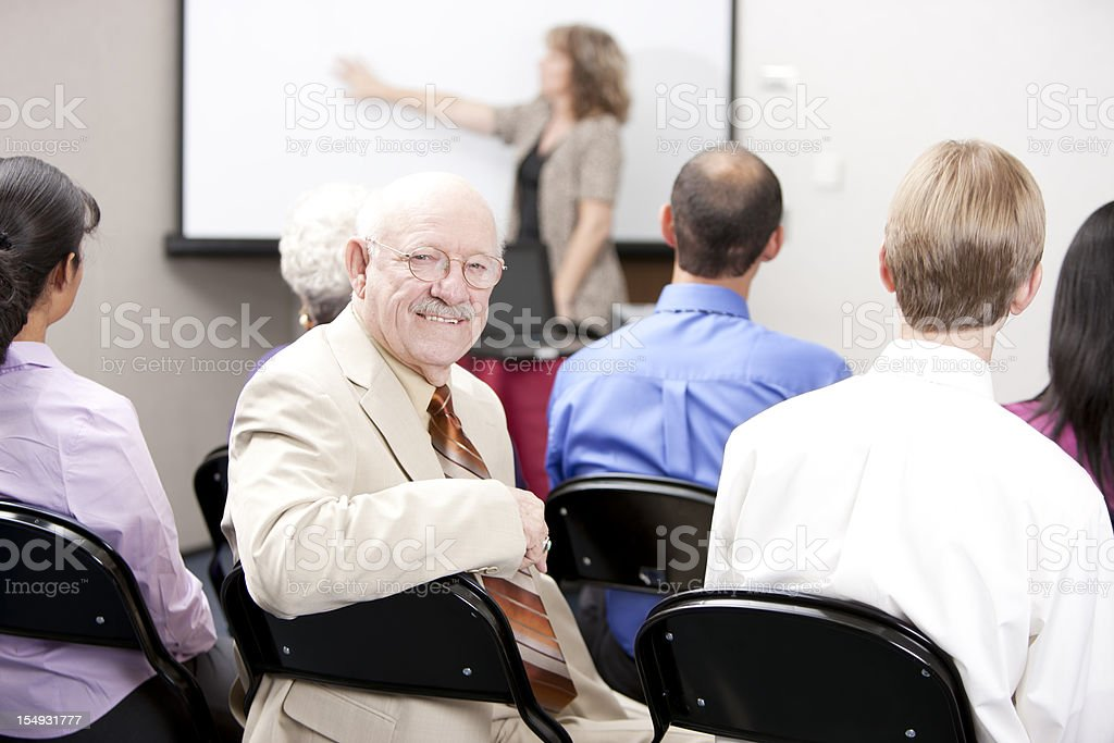Real People:  Caucasian Senior Adult Man Business Presentation Small Group royalty-free stock photo