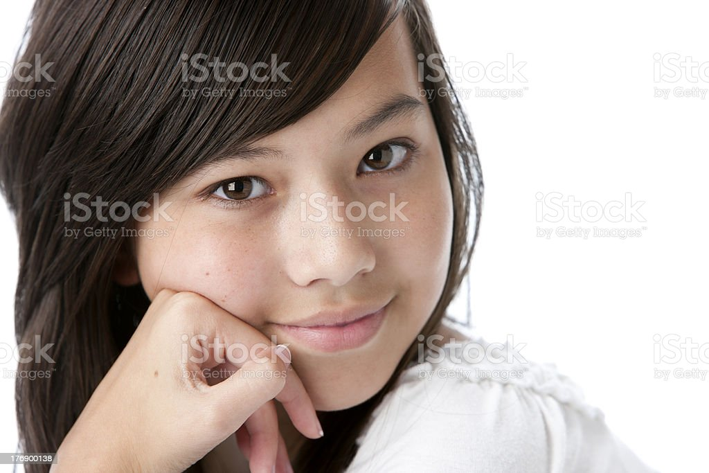 Real People: Closeup Headshot Thoughtful Smiling Asian Teenage Girl royalty-free stock photo